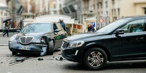 Car accident on PAris street between luxury limousine Lancia Th