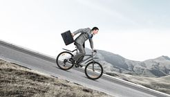 Young man riding bicycle on highway